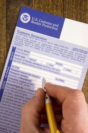 declaration: Filling customs declaration form before passing visa control.