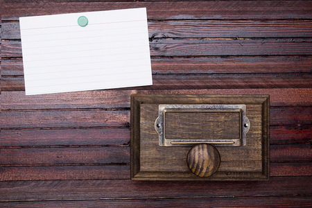 oldstyle: Wooden drawer old-style archive cabinet. Information card.