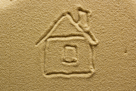 Abstract drawing of a house on sand. Stock Photo