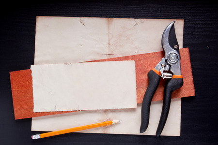 snipping: Industrial garden pruner with paper for the information of the message.