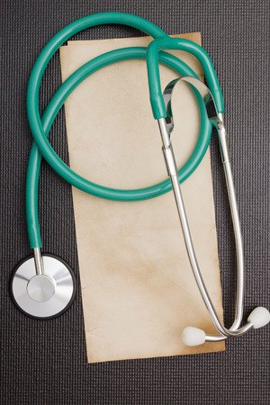 Medical stethoscope on a background of a sheet of paper. Stok Fotoğraf