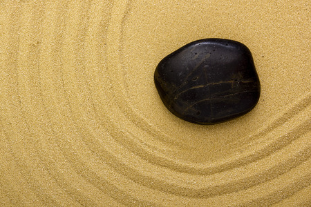 furrow: Culture of the Eastern peoples. Stone on the sand. Stock Photo