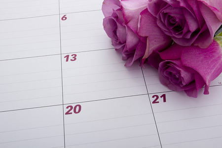 office desk: Office desk calendar with a purple flower.