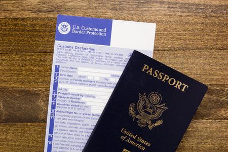 Customs declaration form with a passport, visa preparation passage control.