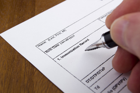 inoculate: Vaccination Documentation sheet filled when performing vaccinations. Stock Photo