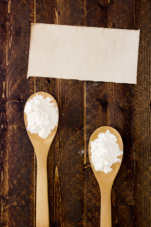 starch: Two wooden kitchen spoon with flour and starch.