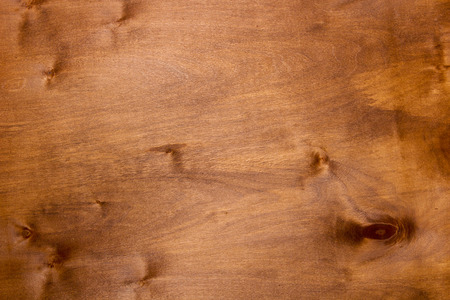 manufactory: Wooden background, a dark-colored plywood for industrial work.