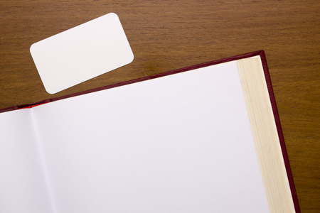 hard cover: Pages of the book open to a blank page with a clear card. Stock Photo