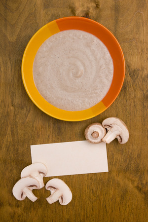 posting: Mushroom soup puree of champignons with paper for posting information.