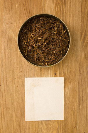 Tobacco for pipe in the tin box and cover note.