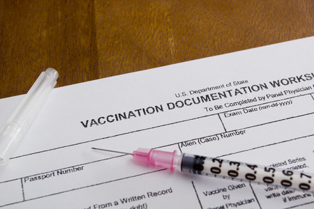 vaccinate: Filling in the form of vaccination. Medical records.