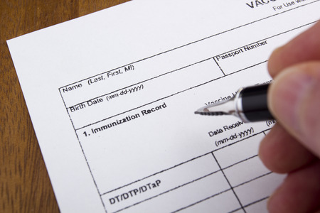vaccinations: Vaccination Documentation sheet filled when performing vaccinations. Stock Photo