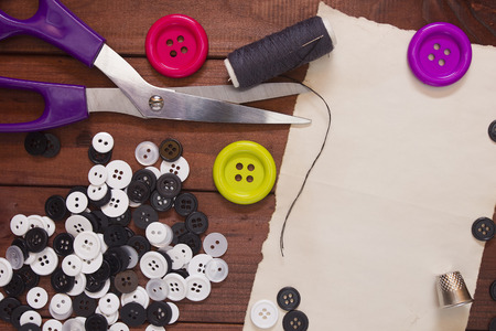 Set of buttons for the repair of clothing and tailoring shears. Stock Photo