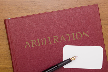 business book: Code of Arbitration - the book and business card for a lawyer.