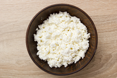 cottage cheese: Culinary cottage cheese in a clay bowl for toppings.