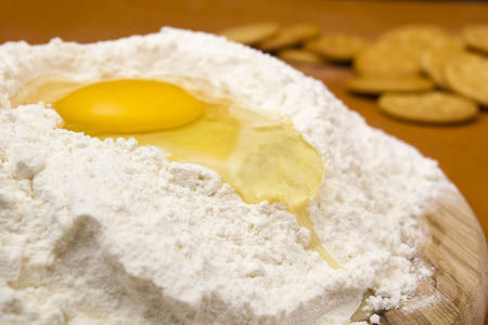 Chicken egg in the flour to knead the dough.