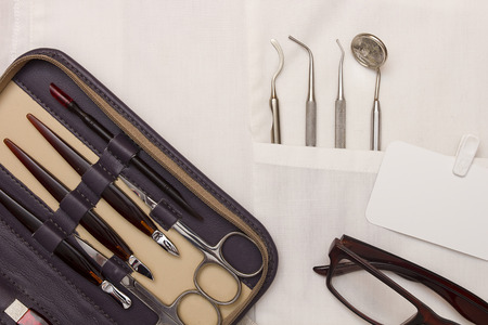 manicure: Attention dentist to your nails, manicure set and dental instruments.