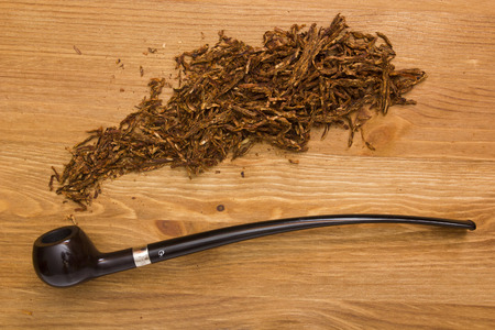 shank: Women tobacco pipe with a long shank and tobacco. Stock Photo