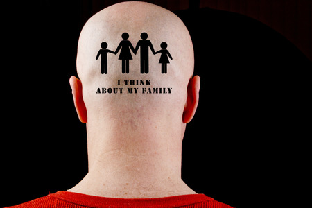 receded: Text on the bald head I think about my family. Stock Photo