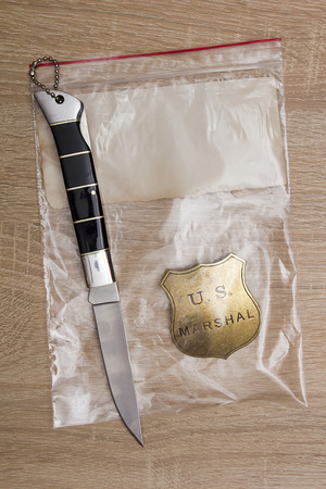 evidence bag: Folding knife crime scene - evidence and marshals character.