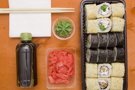 Set of sushi and rolls with wasabi and sauces, Asian traditional food.
