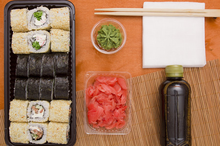 sauces: Set of sushi and rolls with wasabi and sauces, Asian traditional food.