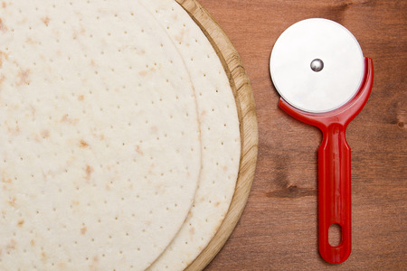 pizza base: Pizza base - cake next round knife for cutting pizza.