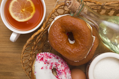 light breakfast: A light breakfast of donuts and tea with lemon.