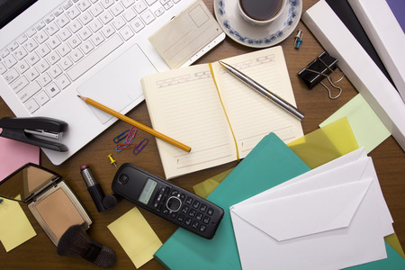 office accessories: Office desk with office accessories and personal care products.