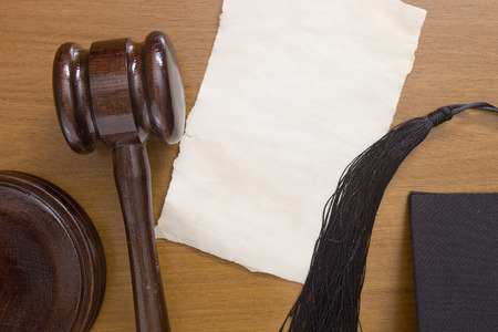 prosecutor: Referee wooden hammer on the table and brush referee traditional caps.