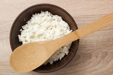 culinary: Culinary cottage cheese in a clay bowl for toppings.