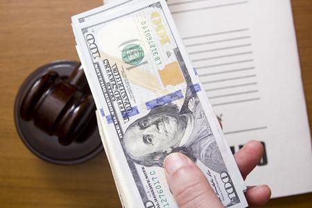 corrupt: Bribe dollars - a symbol of corrupt officials. Stock Photo