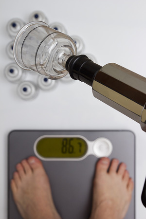 weight control: Tools for vacuum massage - weight control on floor scales.