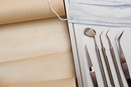 a dentist: A set of tools dentist with parchment for information. Stock Photo