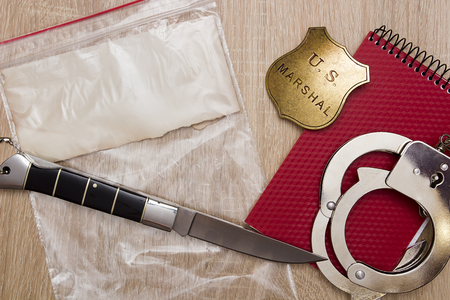 evidence bag: Plastic bag with a knife - evidence to the police. Stock Photo