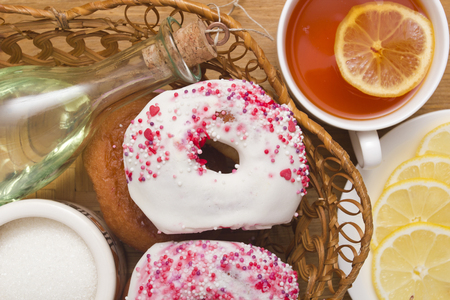 glazes: Traditional donuts fried in oil with colored glaze. Stock Photo
