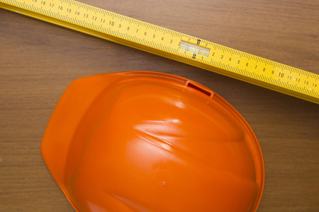 Industrial orange helmet for compliance with safety and building level.