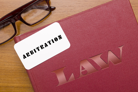 arbitration: Legal Code for arbitration. Book arbitration acts with business card.