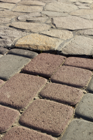 Garden paths of colored decorative bricks and natural stone for landscaping. Stock Photo