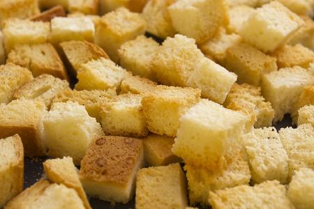 crumbing: Bread crumbs on a baking sheet, roast crackers.