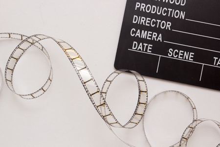 Clapper for the film industry and film.