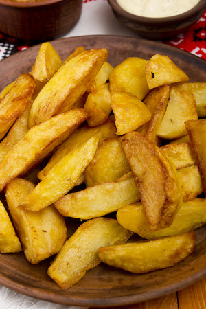 Potatoes fried in lard. Potatoes cooked in the style of rustic roasting.