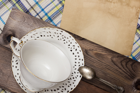 teaspoon: Vintage teacup and saucer and a teaspoon.