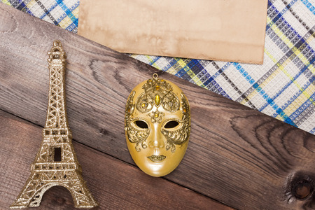 theatre masks: Decorative golden mask with the symbol of the French Eiffel Tower.