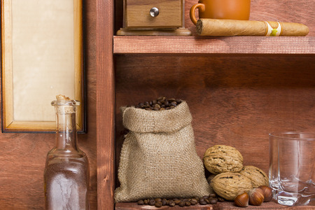 sackcloth: Wooden shelf with coffee beans in the bag.