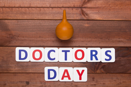 proctologist: Creative on the topic of the day the doctor. Stock Photo