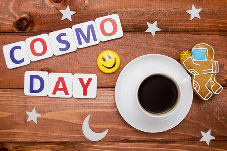 cosmonautics day: Creative composition with the use of cookies in the shape of a cosmonaut and a cup of coffee. Stock Photo