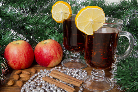 Glasses with Christmas mulled wine, spices and apples. Stock Photo
