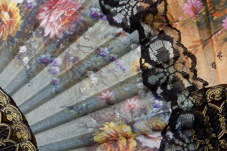 Spanish fan with authentic pattern, flowers on the fan.