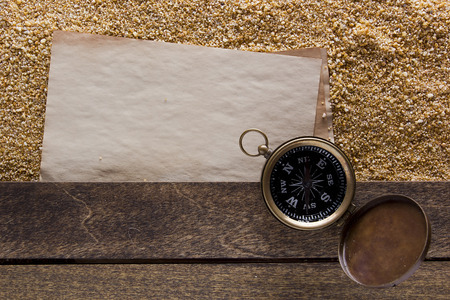 Compass in a metal housing on a wooden platform. Stock Photo - 50525207